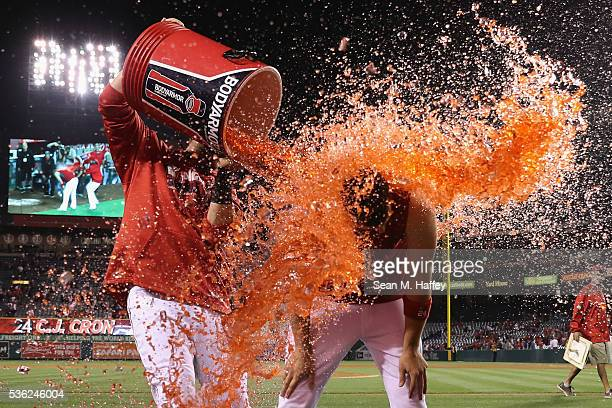 Jett Bandy tosses sports drink on CJ Cron of the Los Angeles Angels of Anaheim after Cron hit a tworun walk off home run during the ninth inning of a...