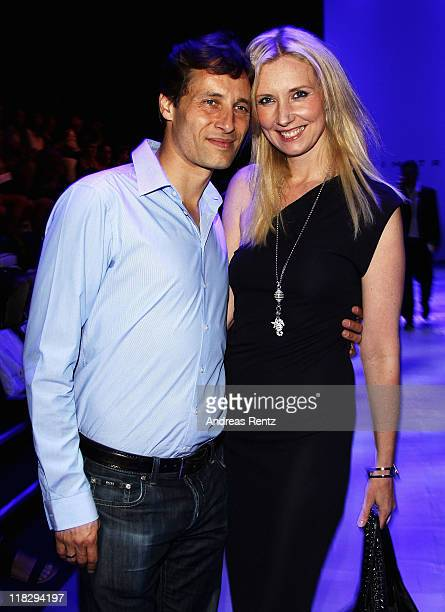 Jette Joop and husband Christian Elsenpose on the catwalk at the Dimitri Show during Mercedes-Benz Fashion Week Berlin Spring/Summer 2012 at the...