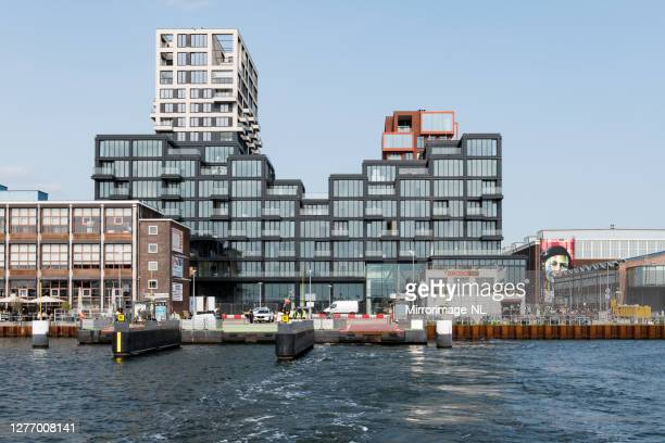 jetties for the ferries of the amsterdam public transport system next to the ndsm shipyard - shipyard stock pictures, royalty-free photos & images