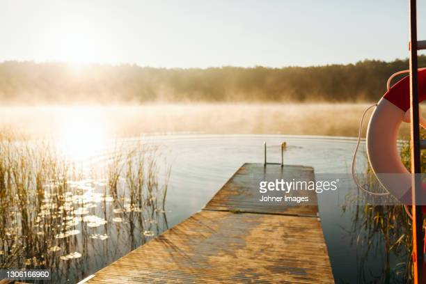 jetty and lake in summer - sweden stock pictures, royalty-free photos & images
