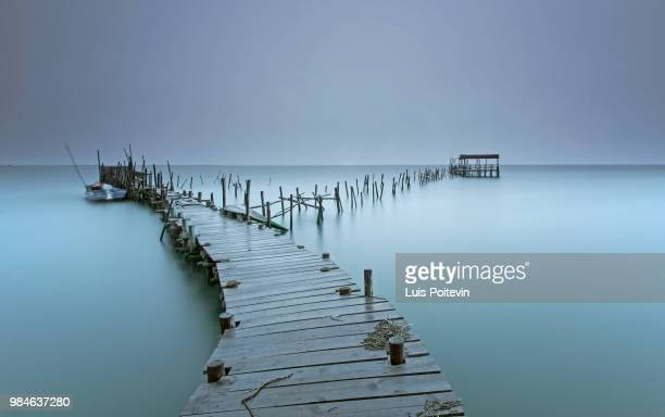 a jetty at a beach in setubal, portugal. - comporta portugal stock photos and pictures