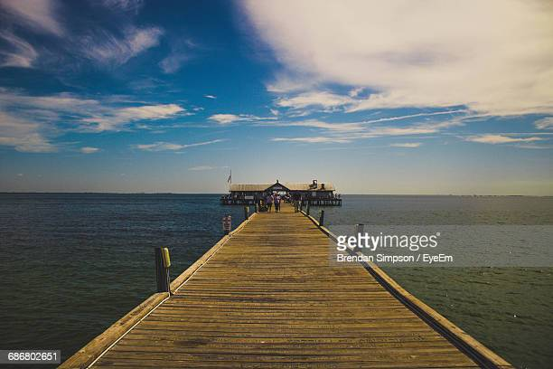 jetty at calm blue sea - anna maria island stock pictures, royalty-free photos & images