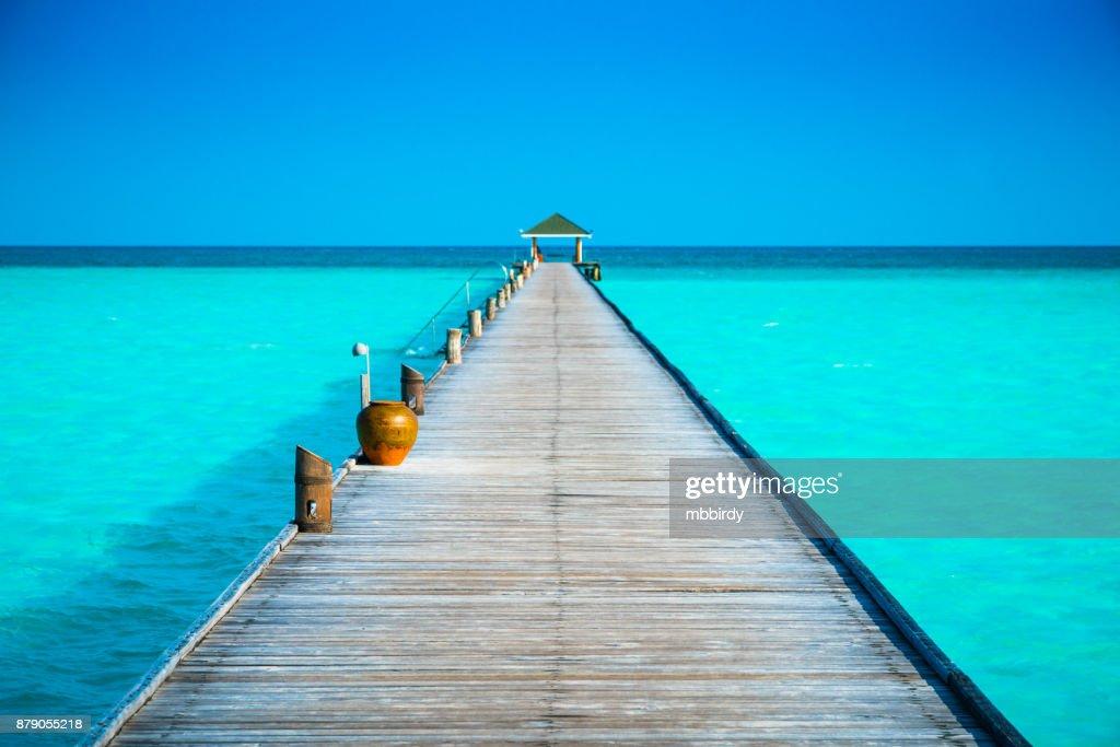 Jetty at Dhiffushi Holiday island, South Ari atoll, Maldives : Stock Photo