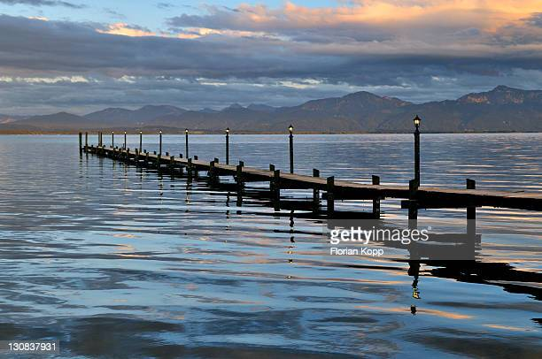 Jetty at dusk on Lake Chiemsee, Chiemgau, Upper Bavaria, Bavaria, Germany, Europe