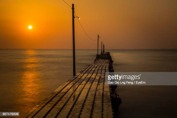 jetty at sea against sky during sunset - 千葉県 ストックフォトと画像