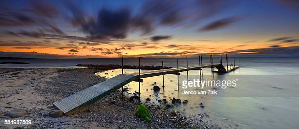 jetty at sunset - funen stock pictures, royalty-free photos & images