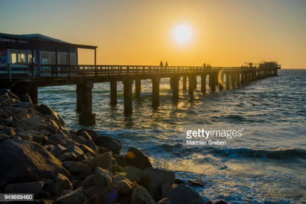 jetty at sunset, swakopmund, erongo region, namibia - erongo stock photos and pictures