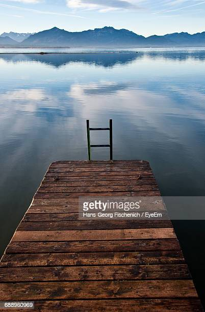 Jetty In Lake Against Sky