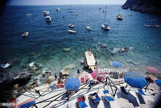 A jetty juts out from a rocky shoreline in Porto Ercole Tuscany August 1980