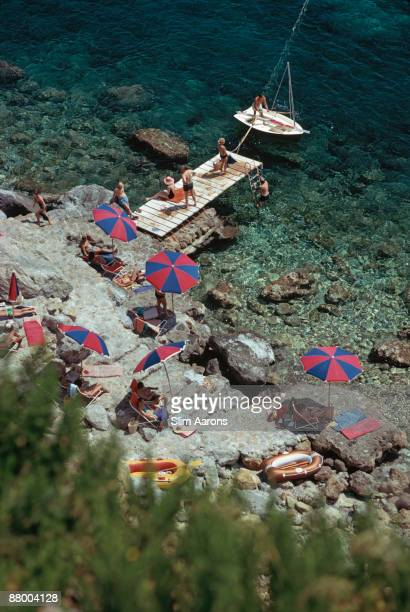 A jetty juts out from the rocky shoreline at the Hotel Il Pellicano in Porto Ercole Tuscany August 1973