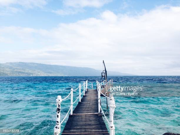 jetty leading to calm sea - negros oriental stock pictures, royalty-free photos & images