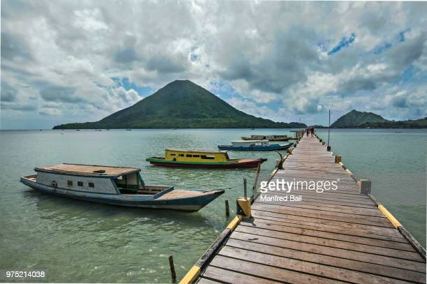 Jetty of Lonthor, the volcano Gunung Api behind, Banda Islands, Moluccas, Indonesia