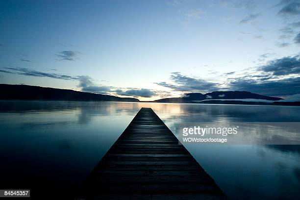 Jetty on lake Tarawera at sunrise