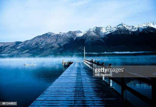 jetty on lake with southern alps in background, glenorchy, queenstown-lakes district, south island, new zealand - 桟橋 ストックフォトと画像