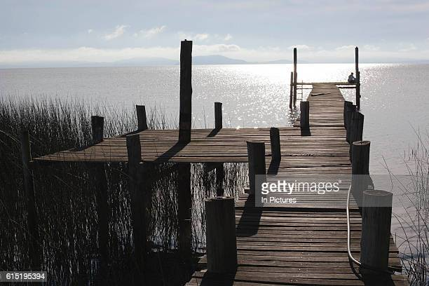 Jetty on the banks of a lake at dawn showing vanishing point Working Gaucho Fazenda in Rio Grande do Sul Brazil