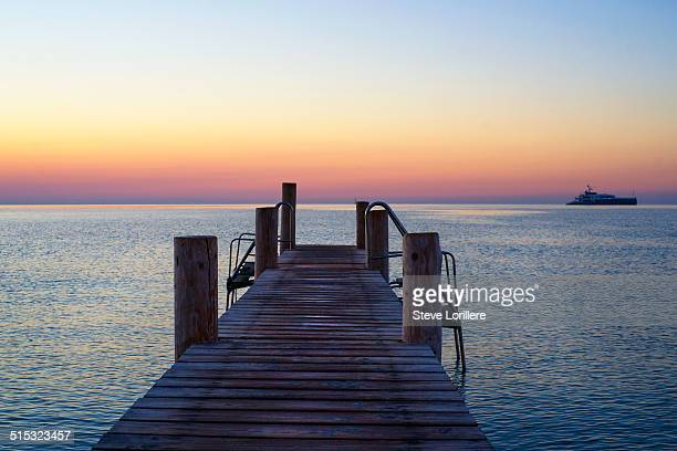 jetty on the beach - ramatuelle stock photos and pictures