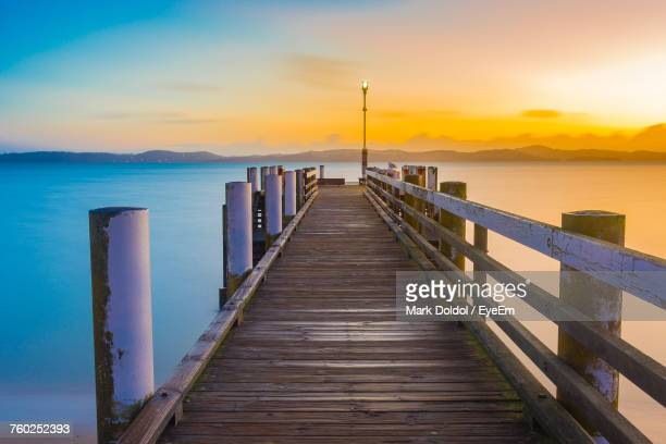 Jetty Over Sea Against Sky During Sunset