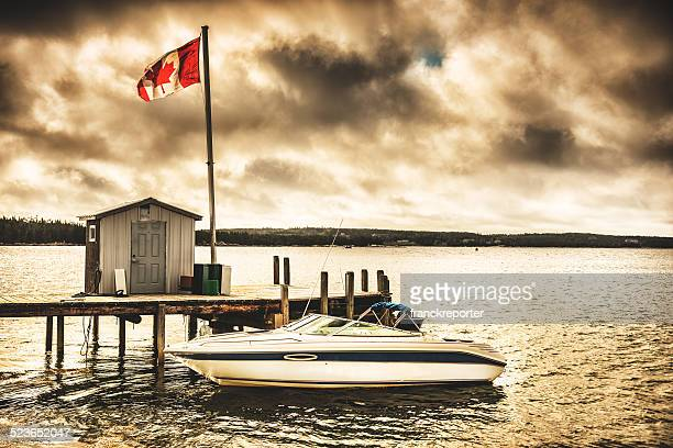 jetty pier on nova scotia landscape - flag of nova scotia stock pictures, royalty-free photos & images