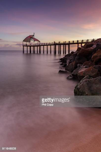 jetty sunrise - townsville queensland stock pictures, royalty-free photos & images