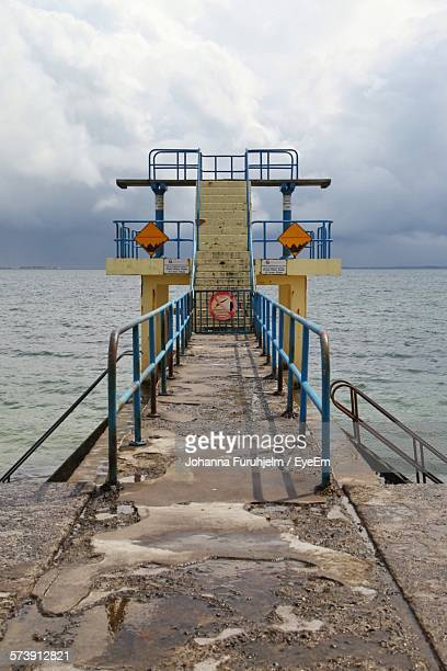 jetty with diving platform by sea against sky - blackrock stock pictures, royalty-free photos & images
