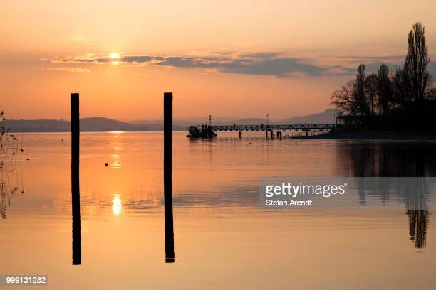 Jetty with solar-powered ferry on the Mettnau peninsula at dusk, Lake Constance, Germany, PublicGround