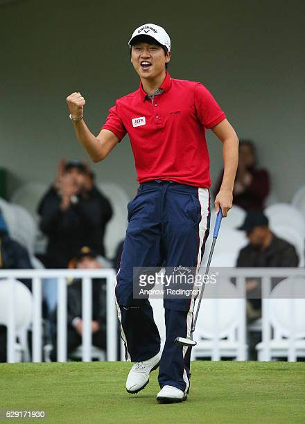 Jeunghun Wang of Korea celebrates a birdie putt on the first hole of the play off with Nacho Elvira of Spain during the fourth and final round of the...