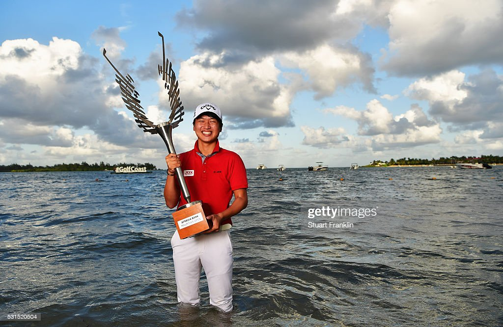 Jeunghun Wang of Korea holds the trophy after winning the AfrAsia Bank Mauritius Open at Four Seasons Golf Club Mauritius at Anahita on May 15, 2016 in Poste de Flacq, Mauritius.