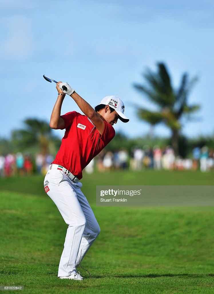 Jeunghun Wang of Korea plays a shot during the final round of AfrAsia Bank Mauritius Open at Four Seasons Golf Club Mauritius at Anahita on May 15, 2016 in Poste de Flacq, Mauritius.