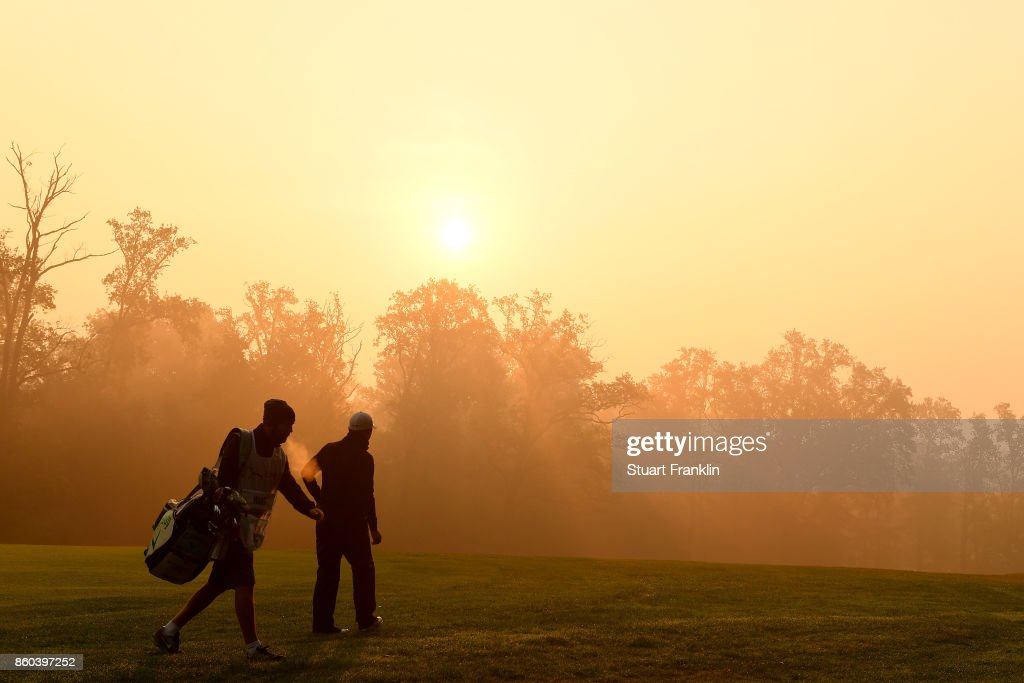 Jeunghun Wang of South Korea and caddy on the 13th hole on Day One of the Italian Open at Golf Club Milano - Parco Reale di Monza on October 12, 2017 in Monza, Italy.