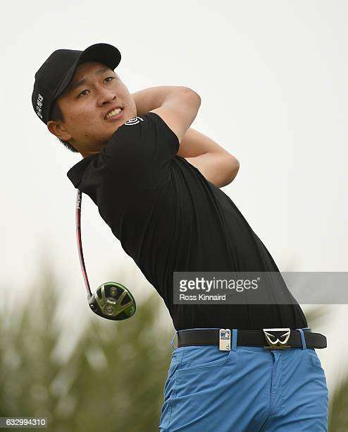 Jeunghun Wang of South Korea hits his tee shot on the 16th hole during the fourth round of the Commercial Bank Qatar Masters at the Doha Golf Club on...