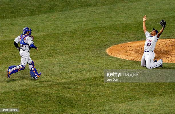 Jeurys Familia and Travis d'Arnaud of the New York Mets celebrate after defeating the Chicago Cubs in game four of the 2015 MLB National League...