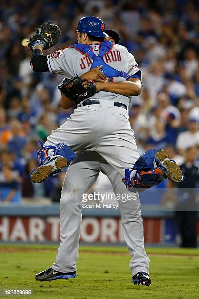 Jeurys Familia and Travis d'Arnaud of the New York Mets celebrate after the Mets 32 victory against the Los Angeles Dodgers in game five of the...