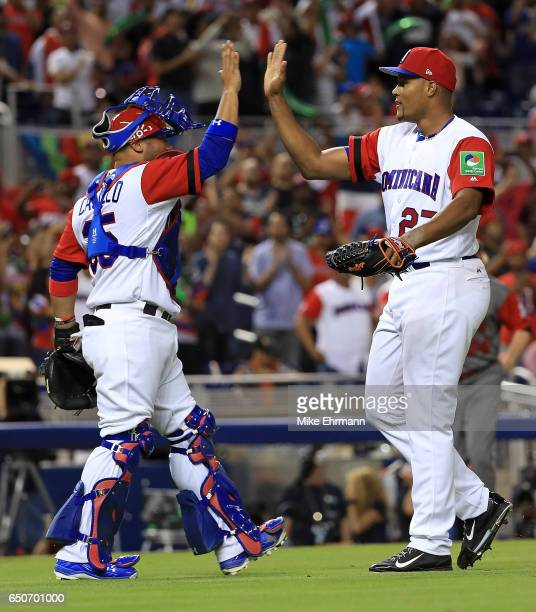Jeurys Familia and Welington Castillo of the Dominican Republic react to winning a Pool C game of the 2017 World Baseball Classic against Canada at...