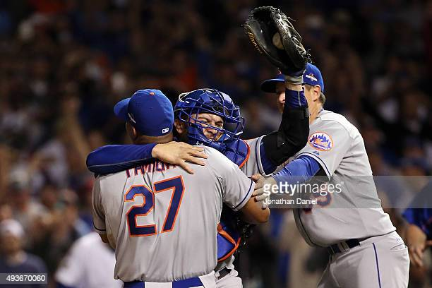 Jeurys Familia Kelly Johnson and Travis d'Arnaud of the New York Mets celebrate after defeating the Chicago Cubs in game four of the 2015 MLB...