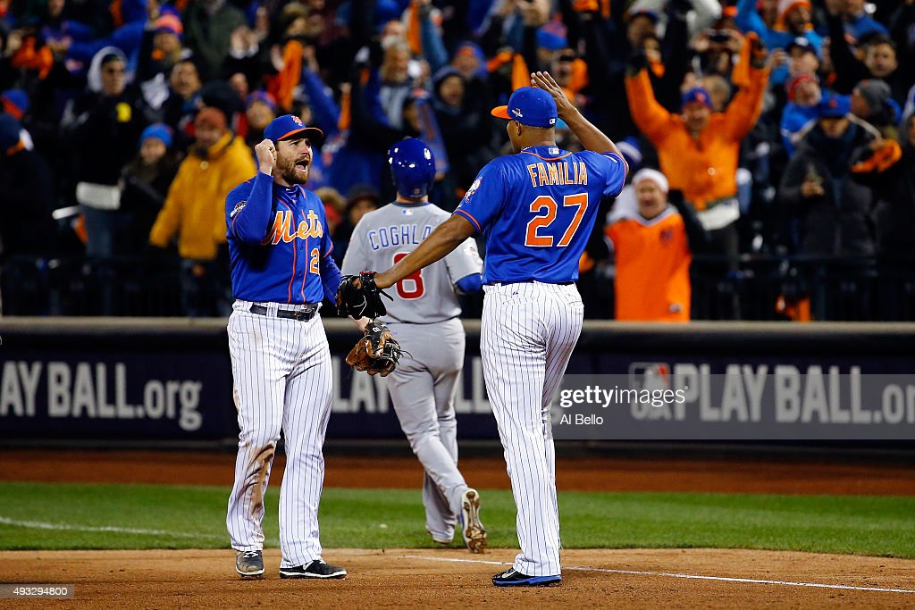 Jeurys Familia #27 of the New York Mets celebrates the final out with Daniel Murphy #28 after defeating the Chicago Cubs in game two of the 2015 MLB National League Championship Series at Citi Field on October 18, 2015 in the Flushing neighborhood of the Queens borough of New York City. The Mets defeated the Cubs with a score of 4 to 1.
