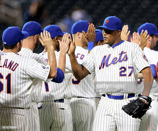 Jeurys Familia of the New York Mets celebrates the win with teammates after the game against the Atlanta Braves on July 8 2014 at Citi Field in the...