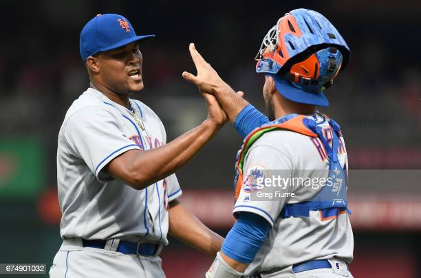 Jeurys Familia of the New York Mets celebrates with Rene Rivera after a 53 victory against the Washington Nationals at Nationals Park on April 29...