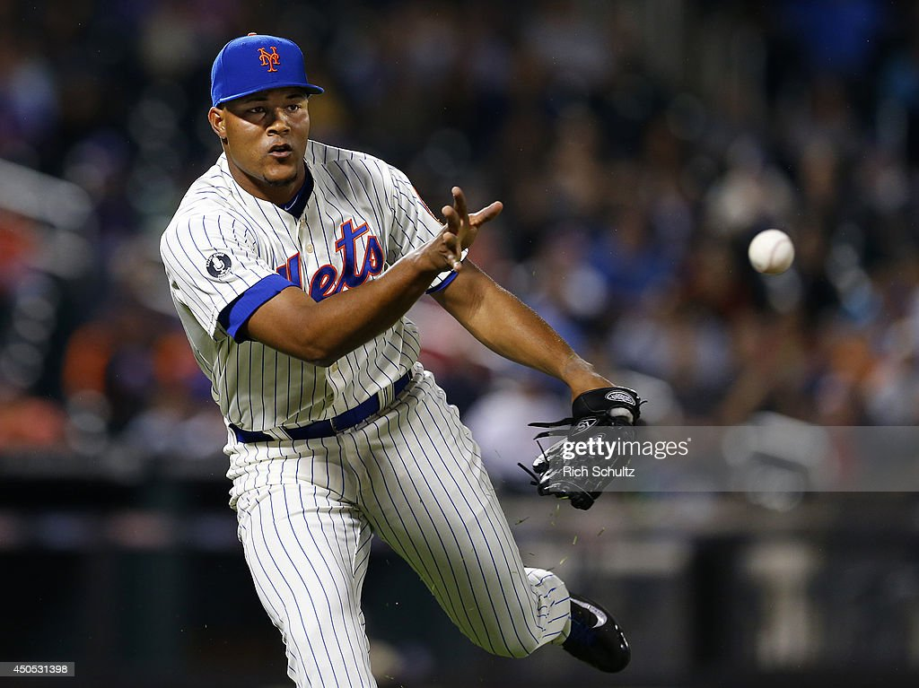Jeurys Familia #27 of the New York Mets flips the ball to first base to get Jean Segura #9 of the Milwaukee Brewers to end the ninth inning on June 12, 2014 at Citi Field in the Flushing neighborhood of the Queens borough of New York City. The Brewers defeated the Mets 5-1 in 13 innings.
