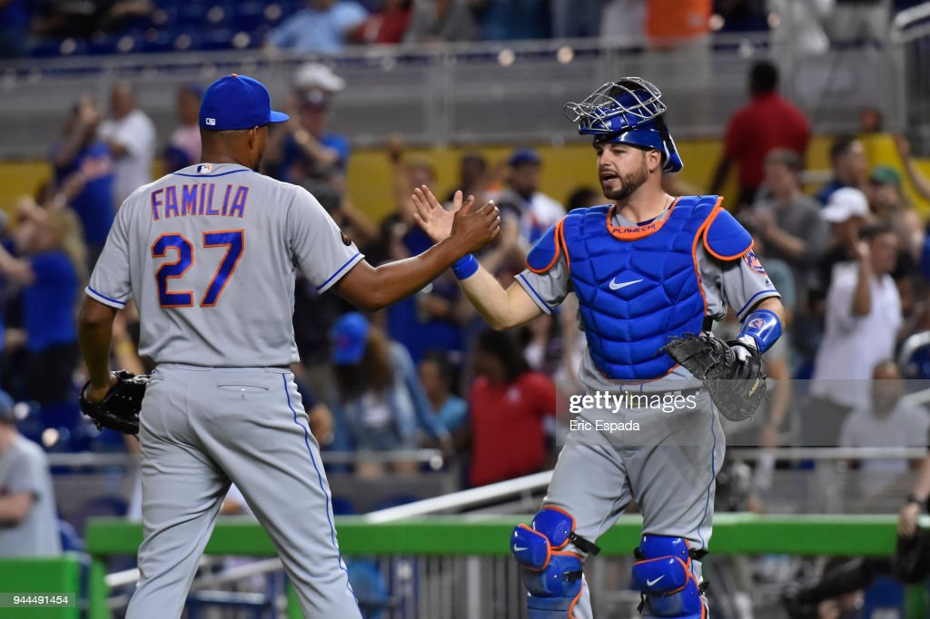 Jeurys Familia #27 of the New York Mets is congratulated by Kevin Plawecki #26 after defeating the Miami Marlins at Marlins Park on April 10, 2018 in Miami, Florida.