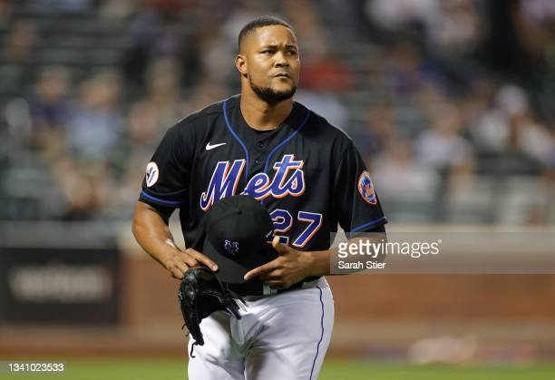 Jeurys Familia of the New York Mets reacts after coming off the mound during the eighth inning against the Philadelphia Phillies at Citi Field on...