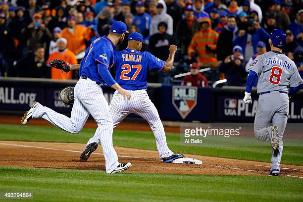 Jeurys Familia of the New York Mets tags out Chris Coghlan of the Chicago Cubs for the final out to defeat the Chicago Cubs in game two of the 2015...