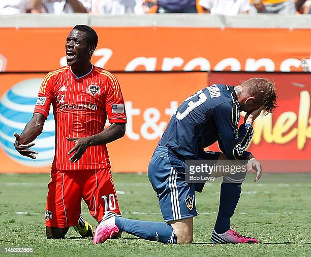JeVaughn Watson of the Houston Dynamo pleads his case as David Beckham of the Los Angeles Galaxy kneels on the grass in pain in the second half at...