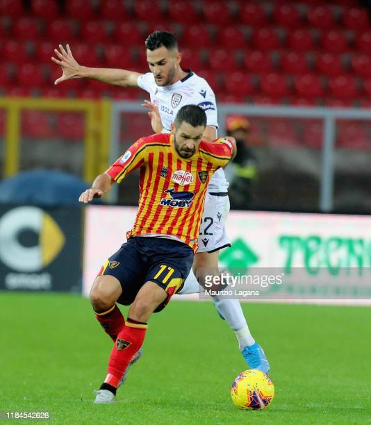 Jevhen Shakov of Lecce competes for the ball with Charalampos Lykogiannis of Cagliari during the Serie A match between US Lecce and Cagliari Calcio...