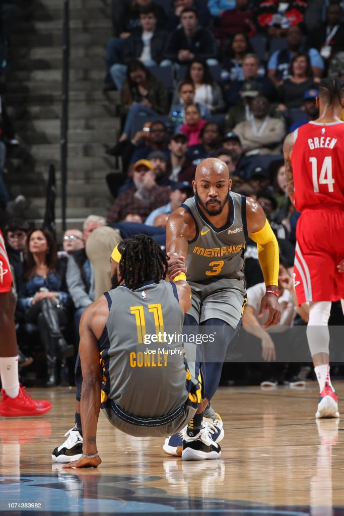 e05beca6e Jevon Carter helps Mike Conley of the Memphis Grizzlies from the ...