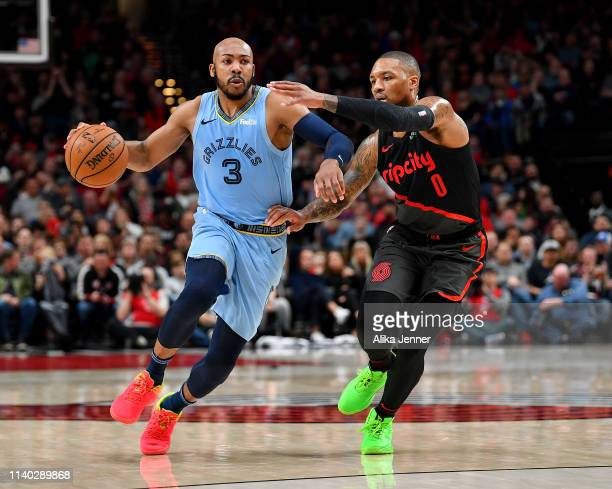 Jevon Carter of the Memphis Grizzlies drives past Damian Lillard of the Portland Trail Blazers during the second half at the Moda Center on April 03...