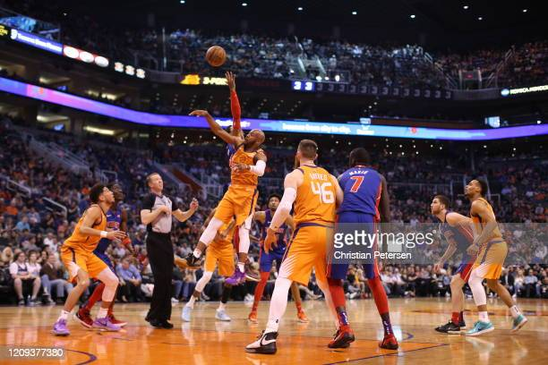Jevon Carter of the Phoenix Suns and Derrick Rose of the Detroit Pistons go up for a jump ball during the first half of the NBA game at Talking Stick...