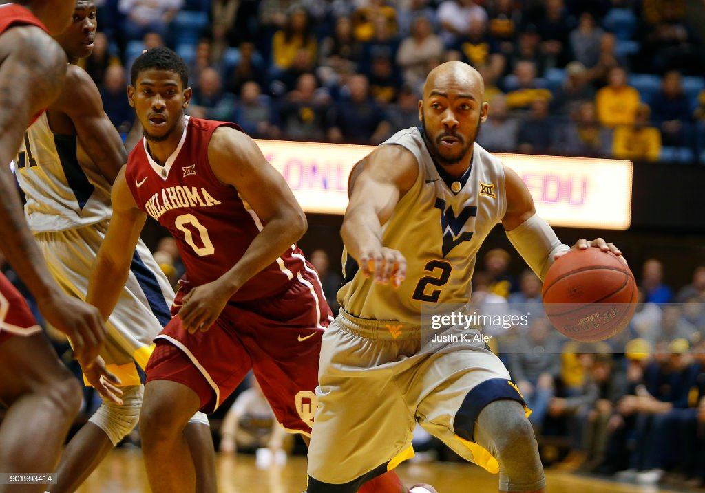 Jevon Carter #2 of the West Virginia Mountaineers brings the ball down court against Christian James #0 of the Oklahoma Sooners at the WVU Coliseum on January 6, 2018 in Morgantown, West Virginia.
