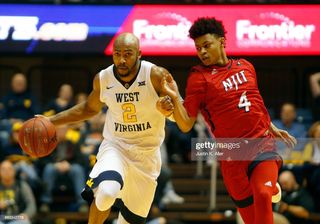 Jevon Carter #2 of the West Virginia Mountaineers brings the ball up court against Zach Cooks #4 of the N.J.I.T Highlanders at the WVU Coliseum on November 30, 2017 in Morgantown, West Virginia.