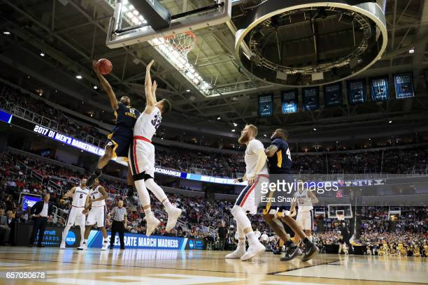 Jevon Carter of the West Virginia Mountaineers goes up against Zach Collins of the Gonzaga Bulldogs in the first half during the 2017 NCAA Men's...