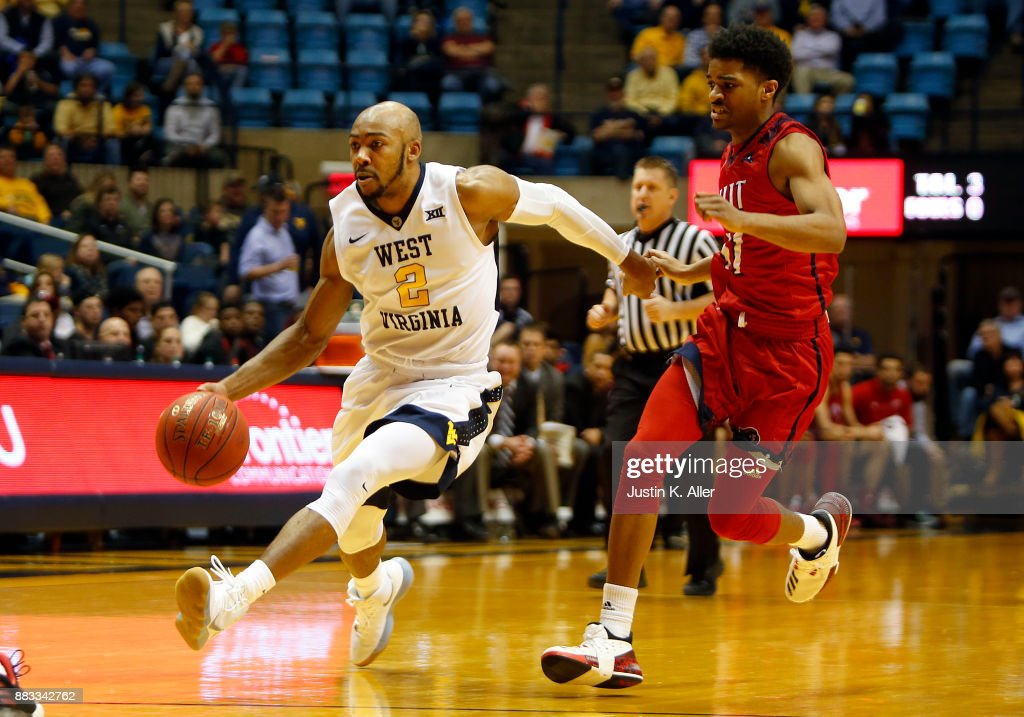 Jevon Carter #2 of the West Virginia Mountaineers handles the ball against Shyquan Gibbs #11 of the N.J.I.T Highlanders at the WVU Coliseum on November 30, 2017 in Morgantown, West Virginia.